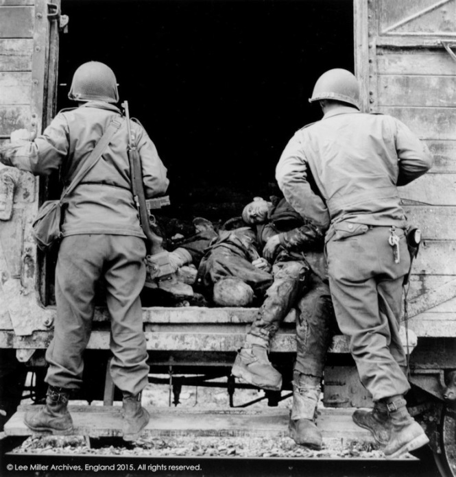 5_US+soldiers+examine+a+rail+truck+loaded+with+dead+prisoners,+Dachau,+Germany,+1945,+76-15